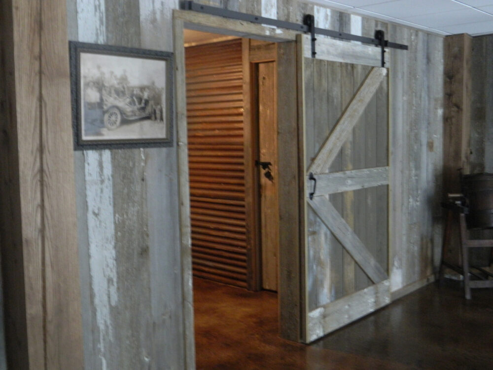 reclaimed custom barn door weathered gray with painted white