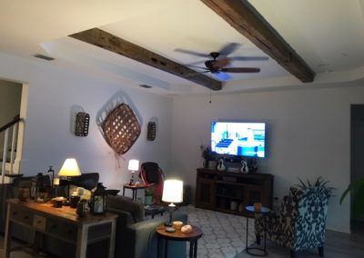 reclaimed hand hewn wood beams in living room ceiling