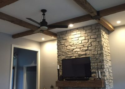 reclaimed hand hewn wood beams with custom reclaimed fireplace mantel