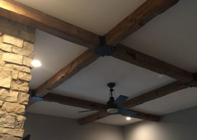 reclaimed hand hewn wood beams in living room
