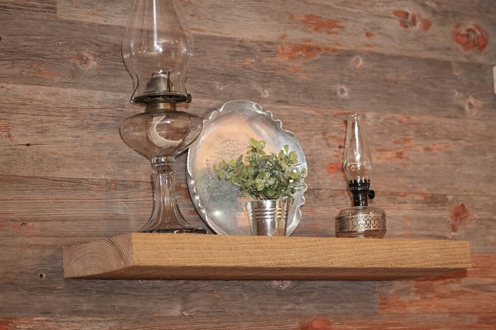 reclaimed wood circle sawn floating shelf with red barn siding