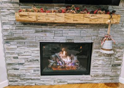custom hand hewn fireplace mantel