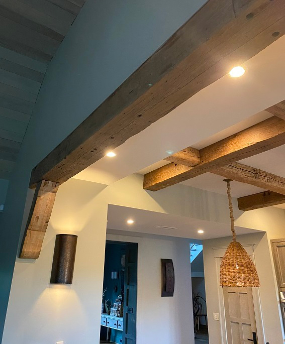 reclaimed mixed hardwood barn siding with reclaimed wood flooring and custom hand hewn ceiling beams
